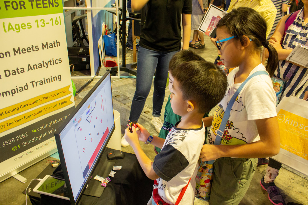 Image of children trying out the maze game with Micro:bit controls