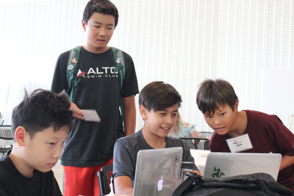 Anthony and Adam sharing their projects excitedly with other participants at the MIT App Inventor Summit, USA