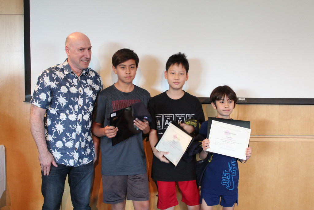 Image of Adam, Anthony and Joshua receiving their award certificates from Mark Friedman, one of the original developers of MIT App Inventor
