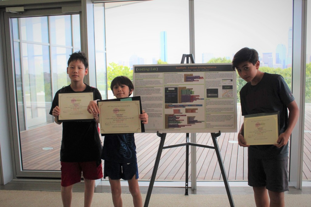 The ecstatic boys having won the 2nd prize for Best Poster Award
