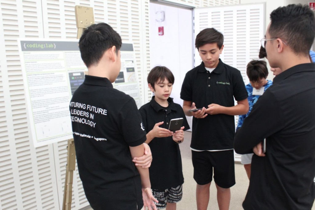 Anthony, Adam, and Joshua presenting their poster which won the 2nd prize at the competition
