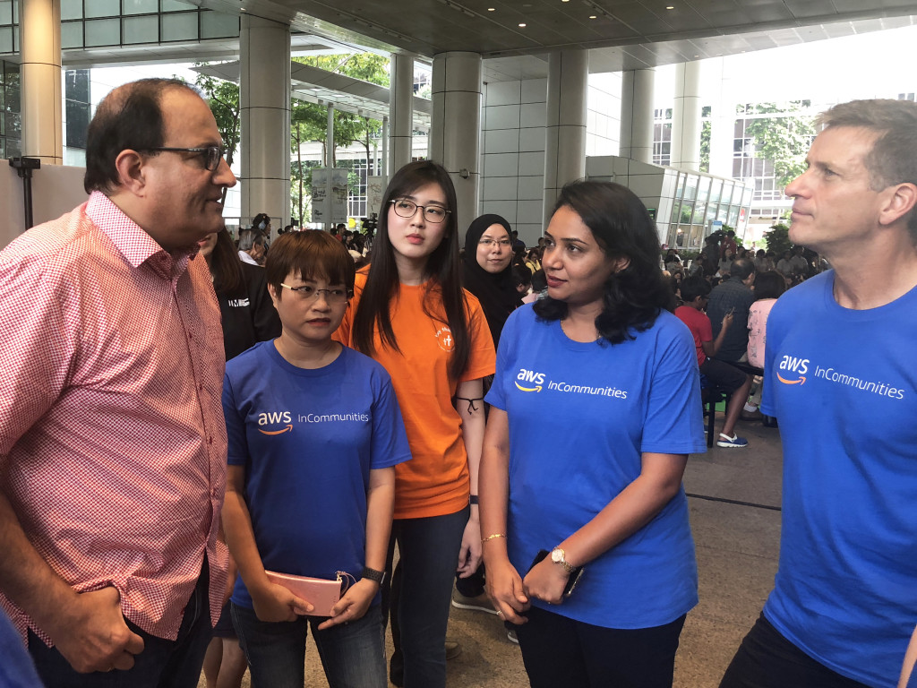 Mr S Iswaran, Minister for Communications and Information, dropped by our booth to have a chat with Thinzar, President of Tiny Thinkers, and our Amazon Web Services volunteers.