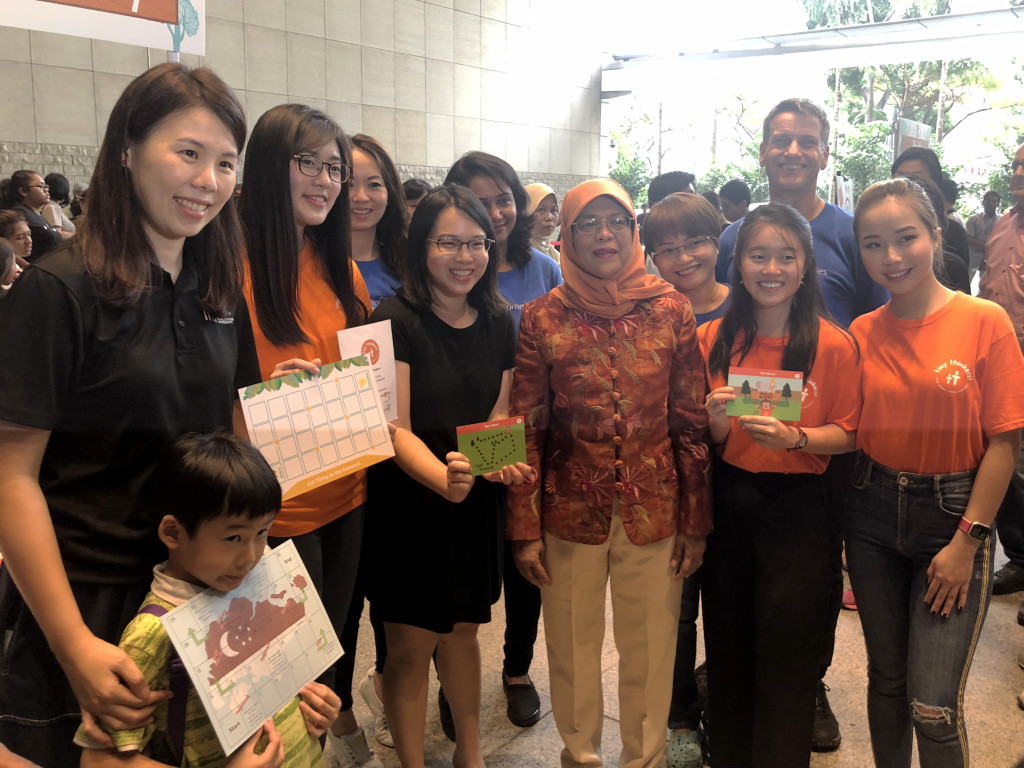 President Halimah Yacob with (from left) Ms Low Tze Hui, Manager of Infocomm Media Development Authority and her son, Thinzar, President of Tiny Thinkers, Candice, Co-Founder of Coding Lab,