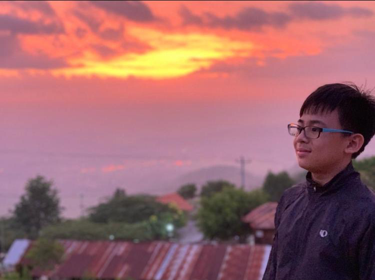 Photo of Ziv with a sunset