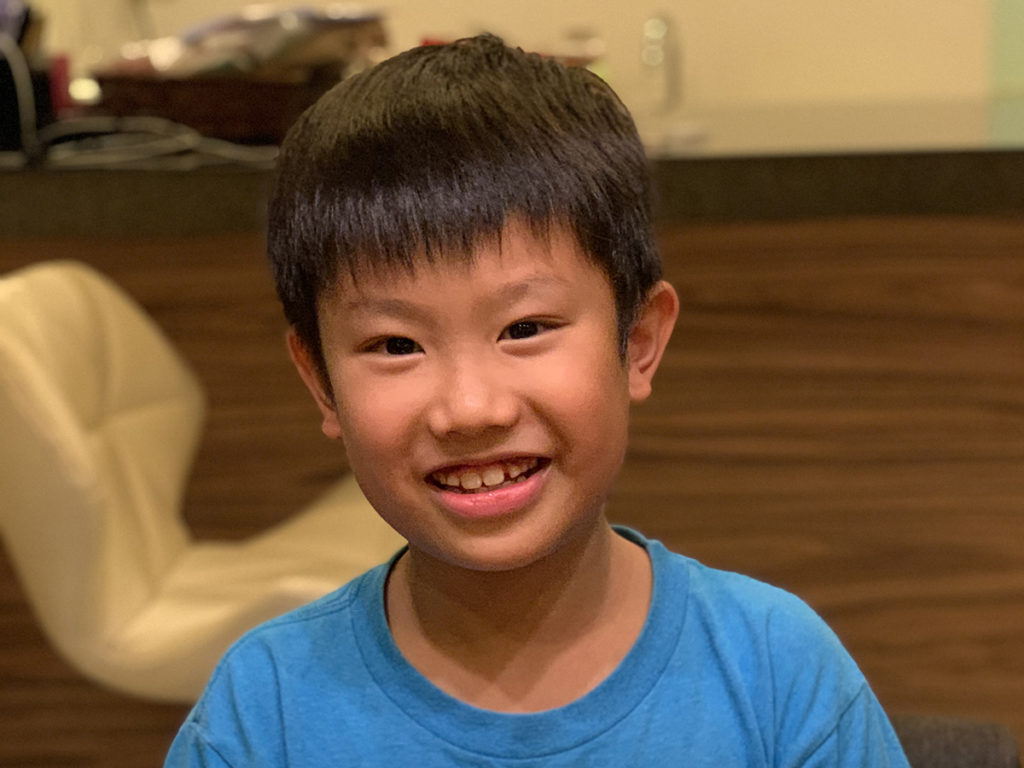 Photo of Jun Min, the 11-year-old who aspires to learn more coding languages.