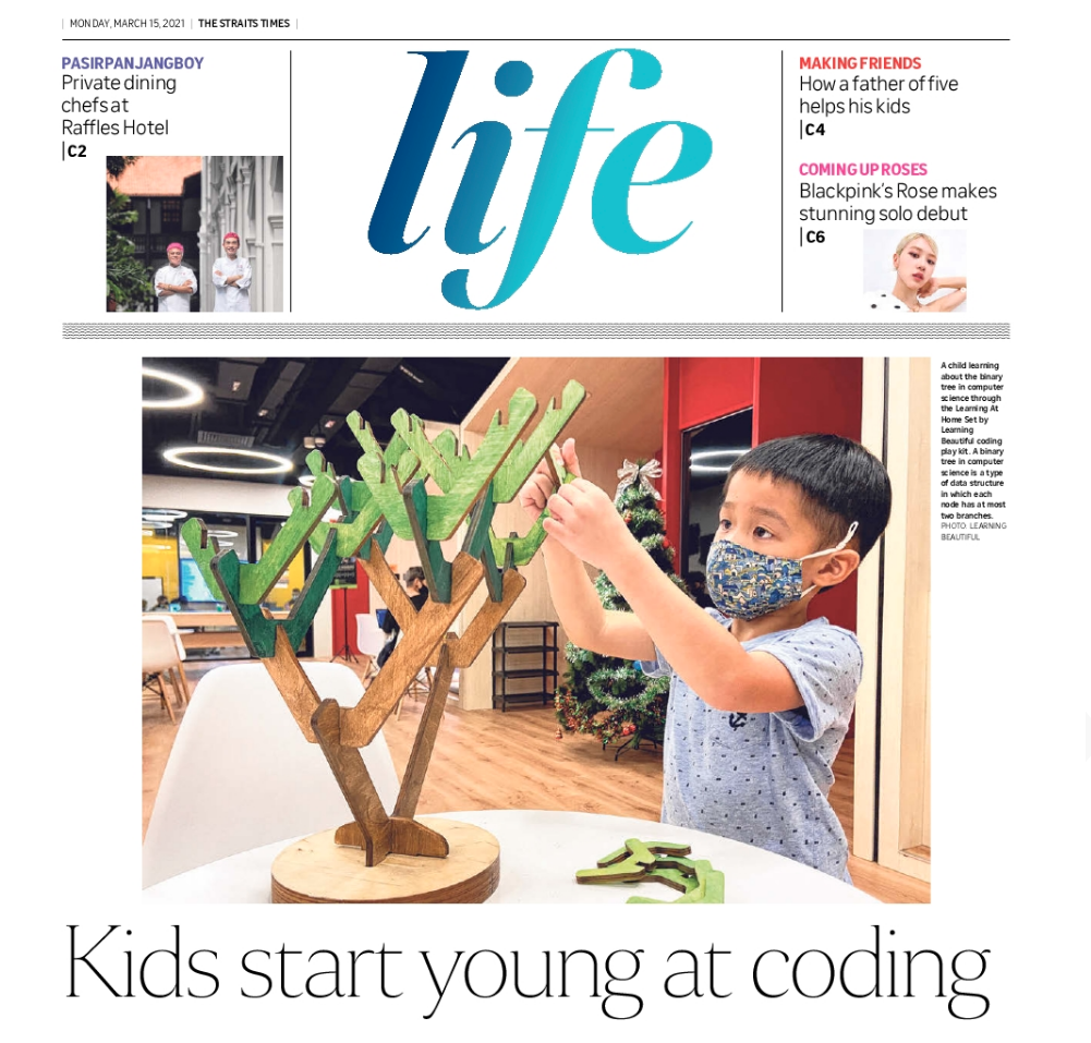 Photo of Life! Front Cover feature of 5-year-old Mitchell playing with Learning Beautiful in our Junior Coders Programme (J11S)